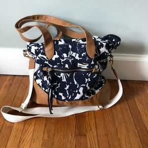 A new day floral print canvas weekender bag